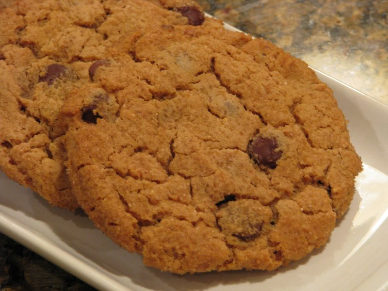 Giant Peanut Butter Cookies with Dark and Milk Chocolate Chips at www.friendsfoodfamily.com