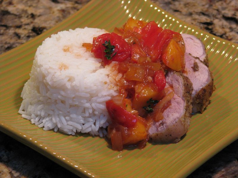 Pork Tenderloin with Tomato - Peach Compote at www.friendsfoodfamily.com
