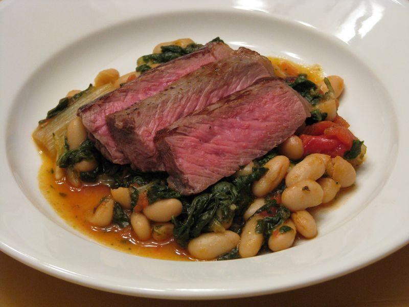 Steak served with Braised Swiss Chard and Cannellini Beans at FriendsFoodFamily.com